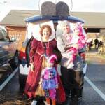 "Photo courtesy Shawna of Cuyahoga Falls, OH, who writes, ""I looked at our car and saw a dragon. So I did a medieval theme. I was the Queen,my husband was a knight, and my daughters were the court jester and pink dragon. We had a smoke machine in the trunk and we won the best display of the night!"""